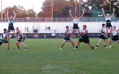 Powder puff cheerleaders perform halftime show