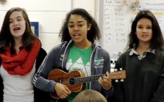 Chorus students carol for classes