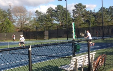 Boys tennis team competes at Kennesaw and Woodstock