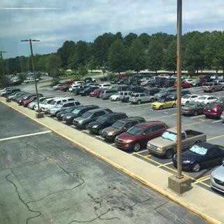 School must address overcrowded parking problem