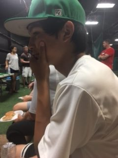 Players wait out rain delay during baseball banquet.
