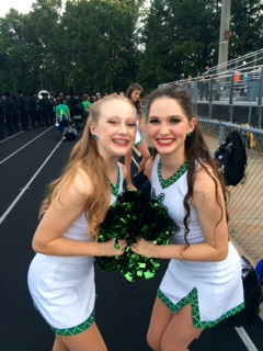 Freshmen Caroline Malloy (left) and Claire Ivory (right) prepare for the Ola vs. McIntosh football game on Friday, Sept. 11.