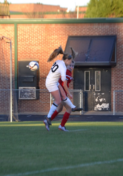 Junior Chandler Witucki goes up for a header.