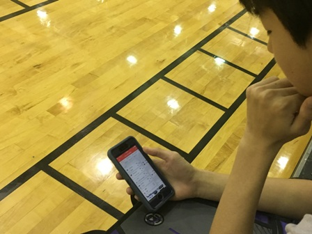 Freshman Tony Liu checks his bracket after the first day of NCAA tournament games.