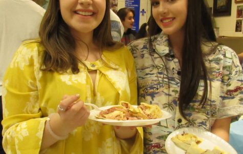 Senior Lee Newton and Junior Jayna Lobl enjoy some of their favorite foods for Food Friday during Foreign Language Week.