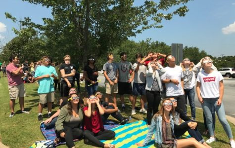 Ms. Bowles' class watches the eclipse from the front parking lot of McIntosh High School