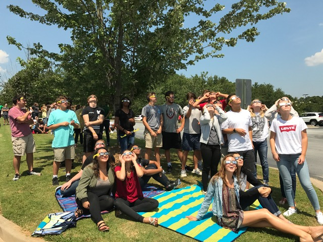 Ms.+Bowles%27+class+watches+the+eclipse+from+the+front+parking+lot+of+McIntosh+High+School