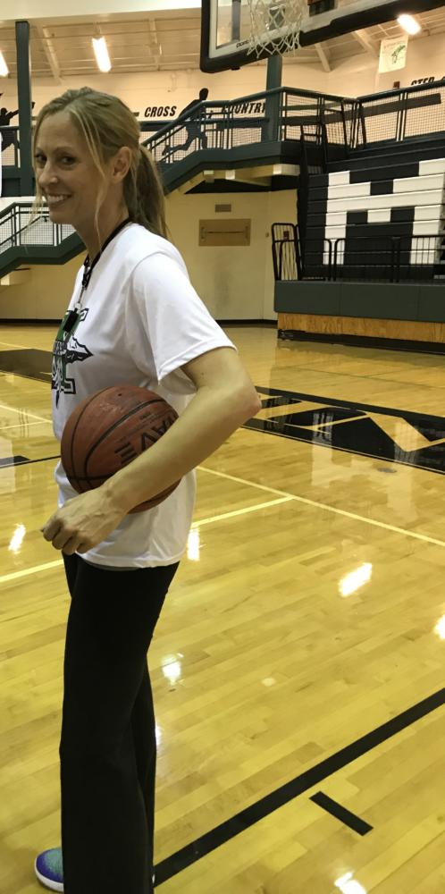 Ms. Carlyle smiles for the camera at a recent basketball practice.