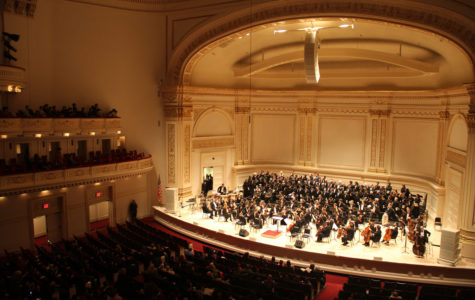 A symphony orchestra performs at Carnegie Hall for the USA-Japan Goodwill Concert in 2013.