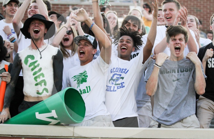 McIntosh Seniors (L-R: Connor Koscevic, Ethan Ange, Zach Pina, Luke Henry) enjoying their final student section experience during the whiteout state championship game at Mercer University.