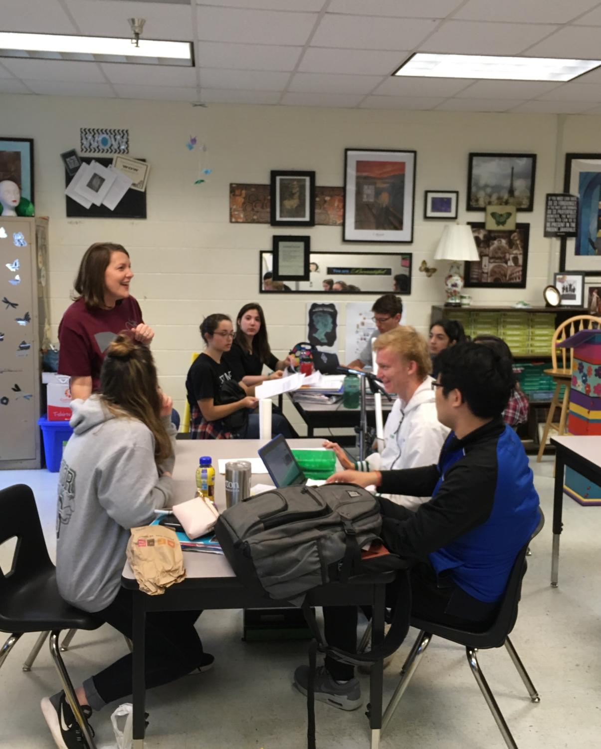 Ms. Walls jokes with her AP Literature class about their end-of-the-year projects.