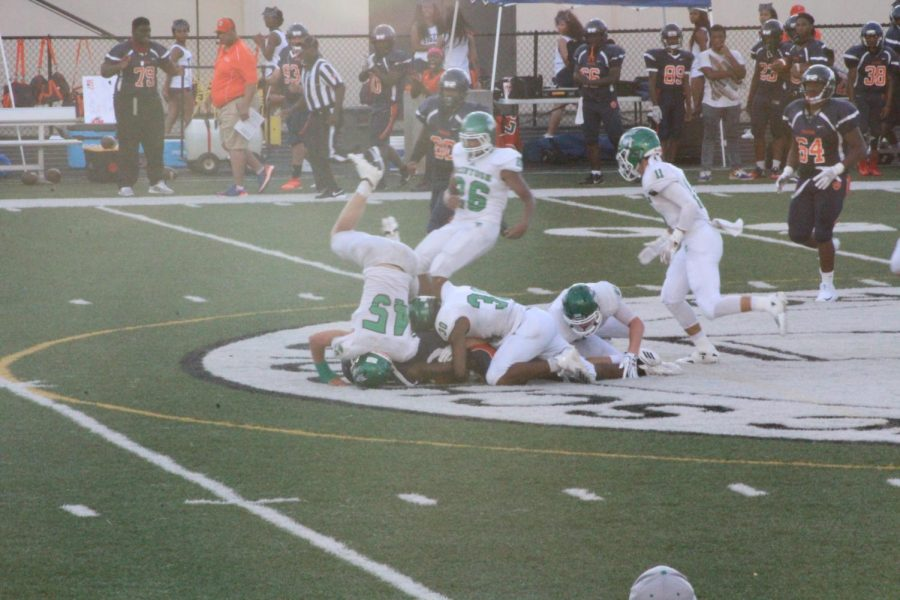 Sanders slamming his head into the ground following a tackle