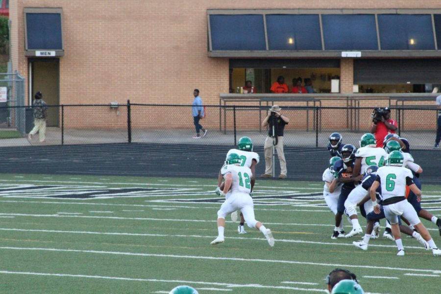 Senior Ryan Cate running the ball into the open field