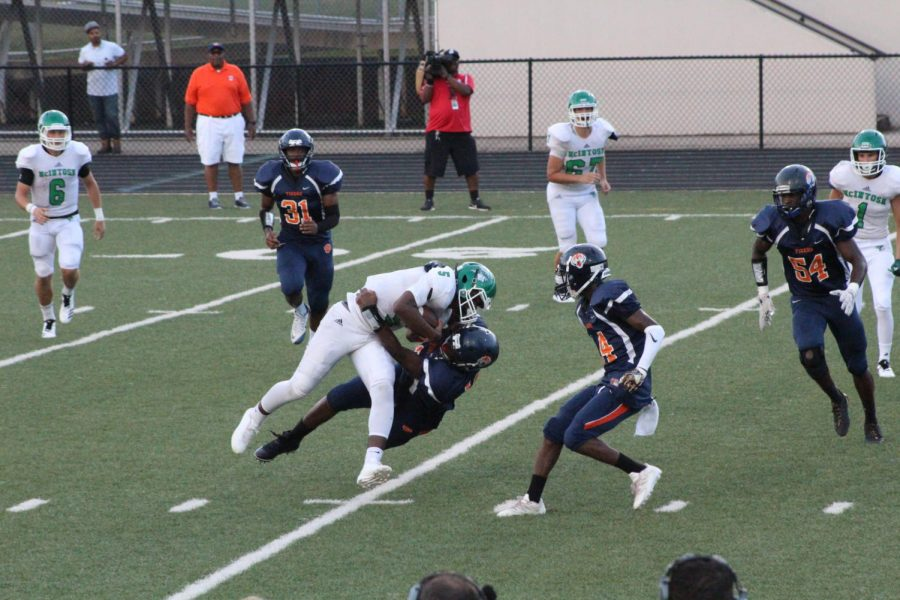 Jaylen Smith getting tackled by the Mundy's Mill defense