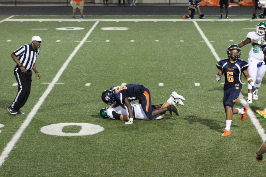 Kinamon on the ground after a hard tackle from Mundy's Mill's defense