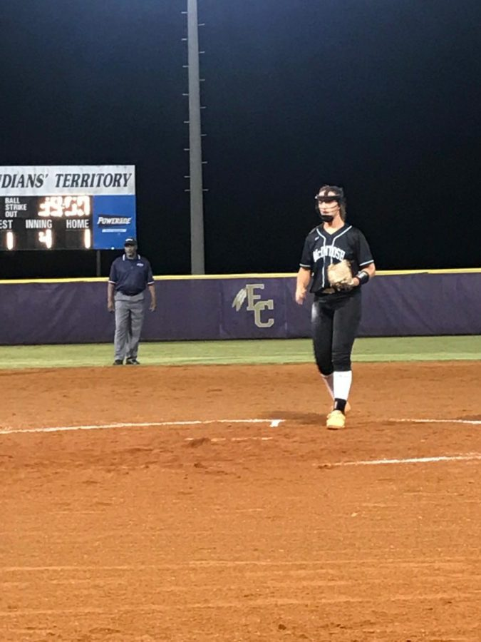 Sophomore+Rebecca+Muh+pitches+at+an+East+Coweta+tournament.+The+team+finished+0-3+in+the+tournament%2C+but+Muh+added+up+more+strike+outs+on+her+record+for+the+season.+Muh+said%2C+%22I+like+the+feeling+I+get+when+I+strike+a+battre+out.%22+Photo+by+Anna+Muh.