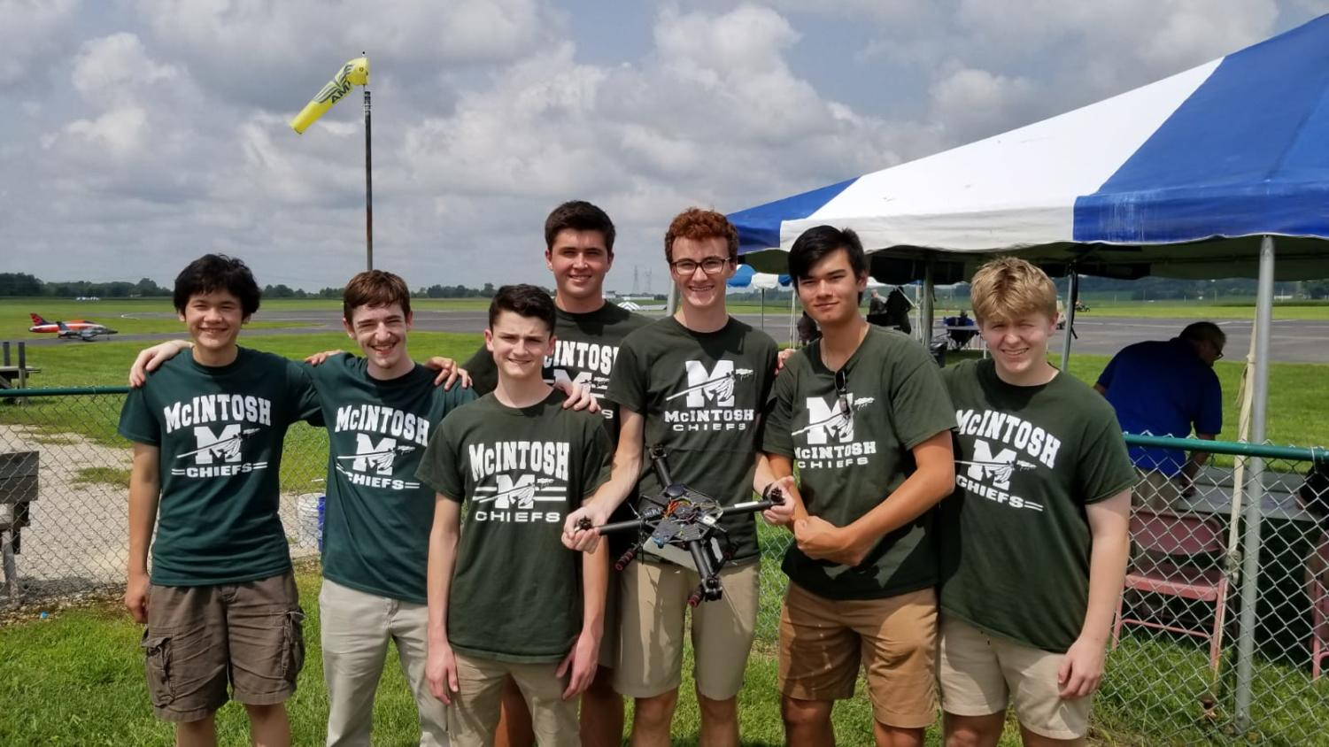 (from left-to-right: Sam Triplett, Luke Wonderley, Logan Connerat, Adrien Richez, Matthew Harmon, Robert Palla, and Noah Statton) Photo Credit: Seth Bishop The Drone Team is lining up for a quick team photo before it is their turn to compete. They would go on to win the competition, securing the national title.