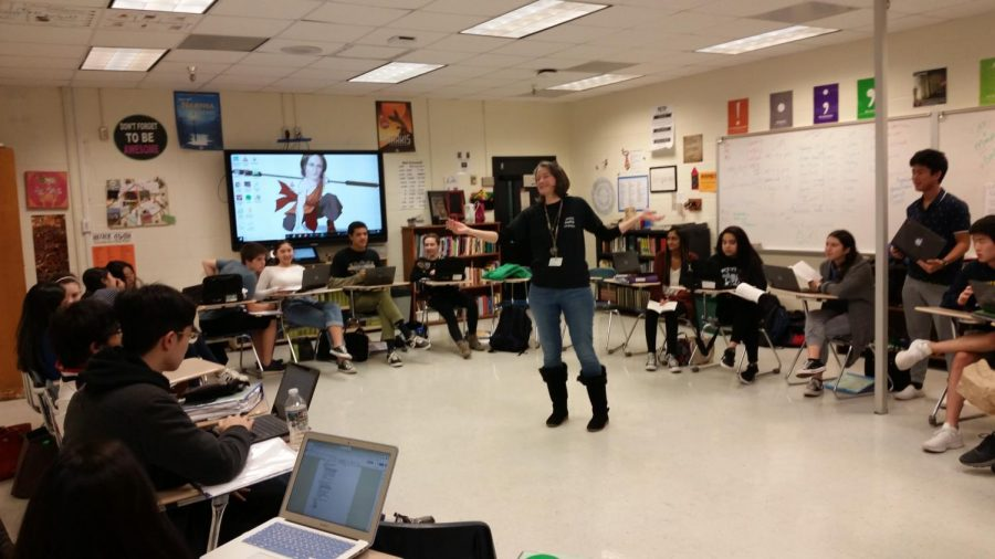 Lakly%2C+in+her+classroom+during+first+period+on+Dec.14%2C+2018%2C+leading+a+group+discussion.+Her+senior+AP+Literature+students+are+practicing+for+the+AP+exam+by+creating+mock+questions+to+quiz+each+other+with.+Photo+Credit%3A+Luke+Wonderley%0A%0A
