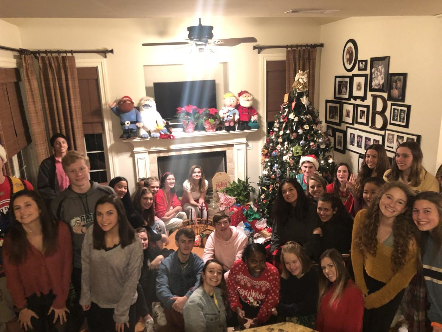Swim Team members pose for a group photo in their Christmas attire.