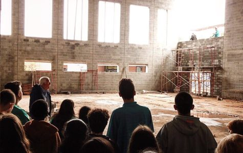 STEM students take a tour through the skeleton of the soon-to-be Multi-purpose room.  Image by Seth Bishop