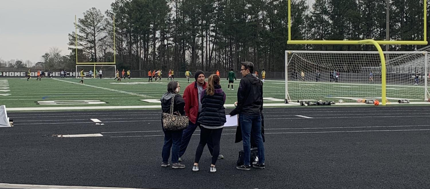 Towards the end of tryouts on Thursday, all the girls' coaches circled up. They discussed how tryouts went and where they would be meeting following tryouts to discuss what team each player would be on for the upcoming season.