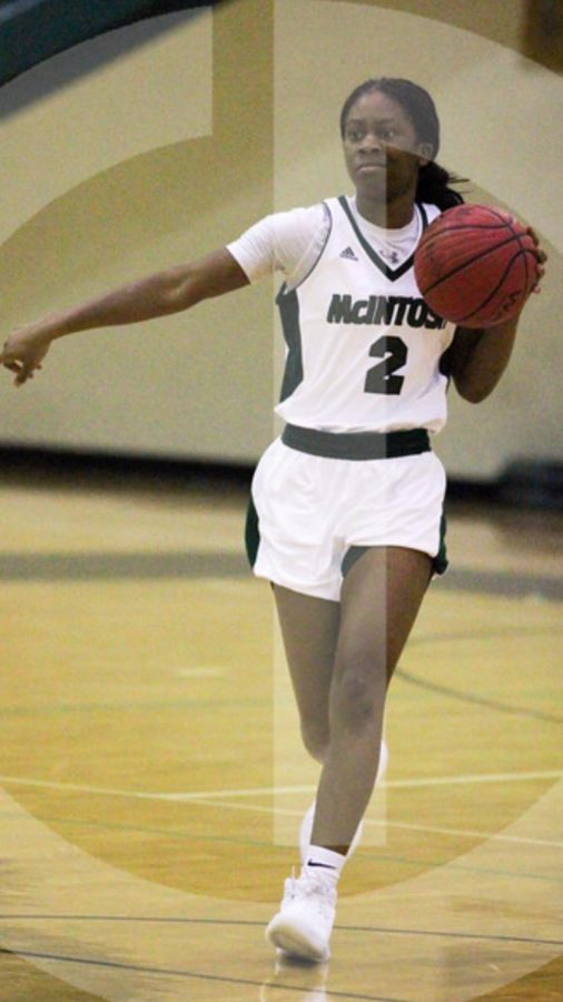 Kennedi+Miller+dribbling+up+the+court+directing+her+teammates+where+to+go+for+the+play.+