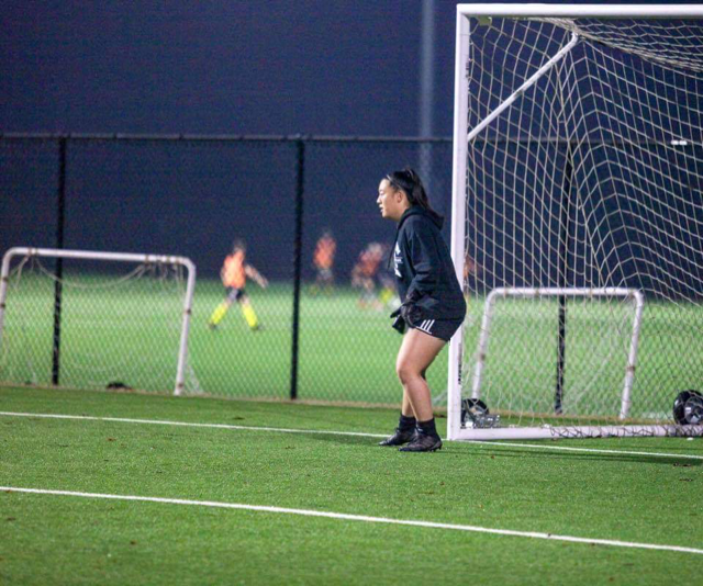 Senior goalkeeper Stephanie Yi defends the goal.