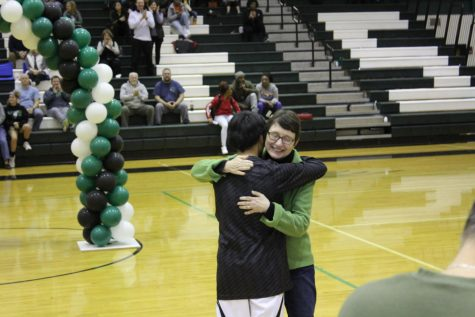 Senior manager Nelson White hugs mother after being recognized for four years of assisting the basketball program.