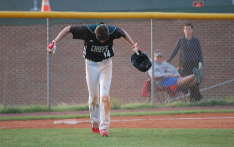 Trey King walks off third base when inning is over.
