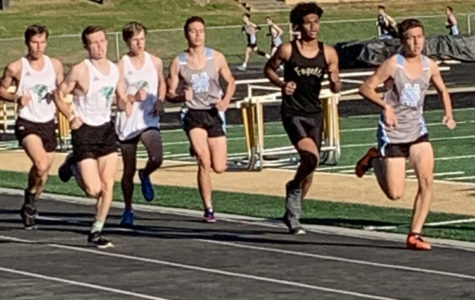 Runners participate in the 1600 at the Fayette County JV track meet.