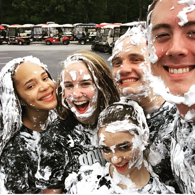 Seniors in the class of 2016 after their shaving cream fight in the parking lot.