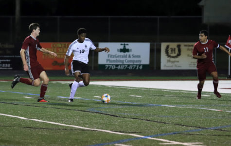 Baba Agbaje takes on defender during past game against Whitewater.