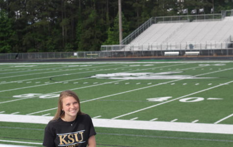 Senior Kamryn Torr, Editor in Chief, poses in her Kennesaw State shirt.