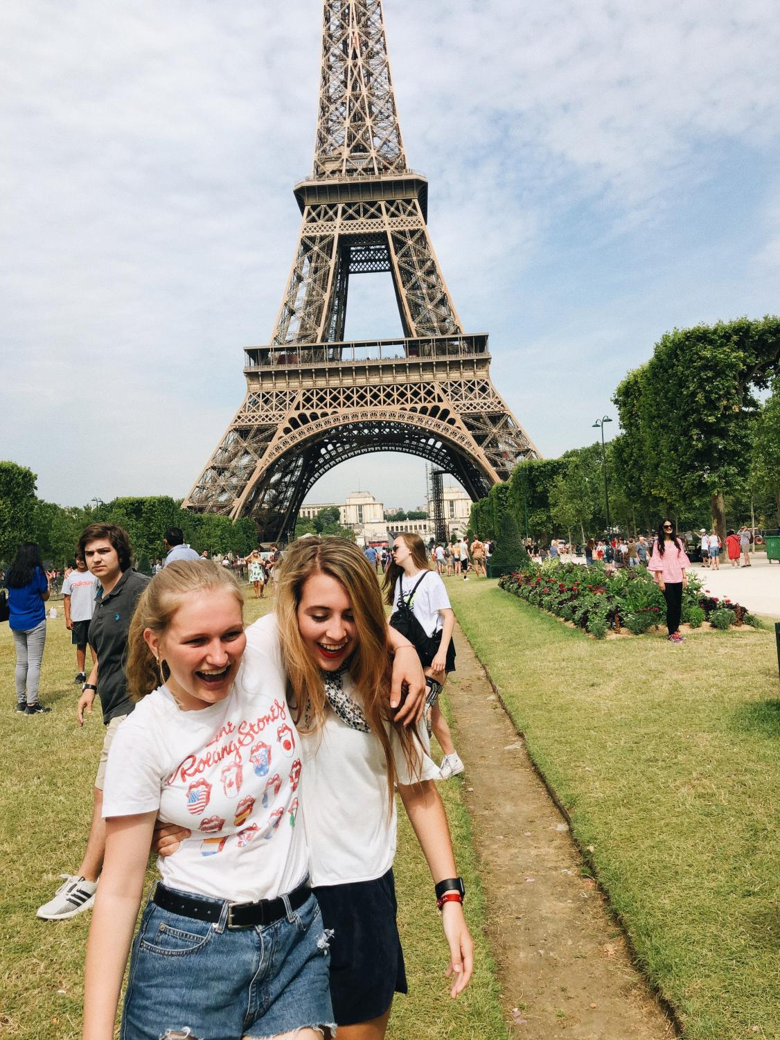 Junior Brooke Boucher (left) and senior Ava Kreitner (right) enjoy their time in Paris in front of the Eiffel Tower.