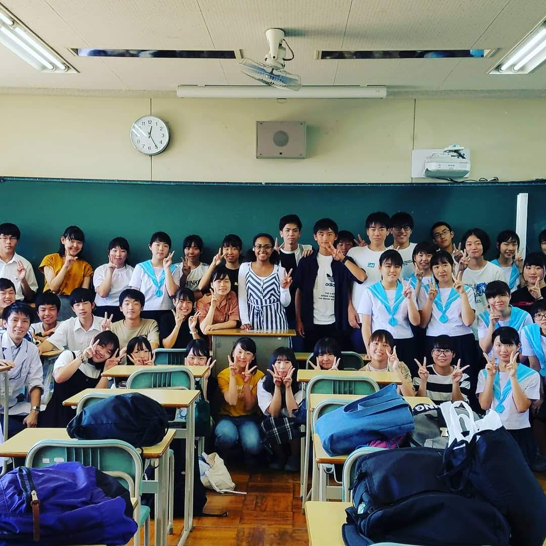 Junior Brooke Winters (center) stands with her Japanese classmates.