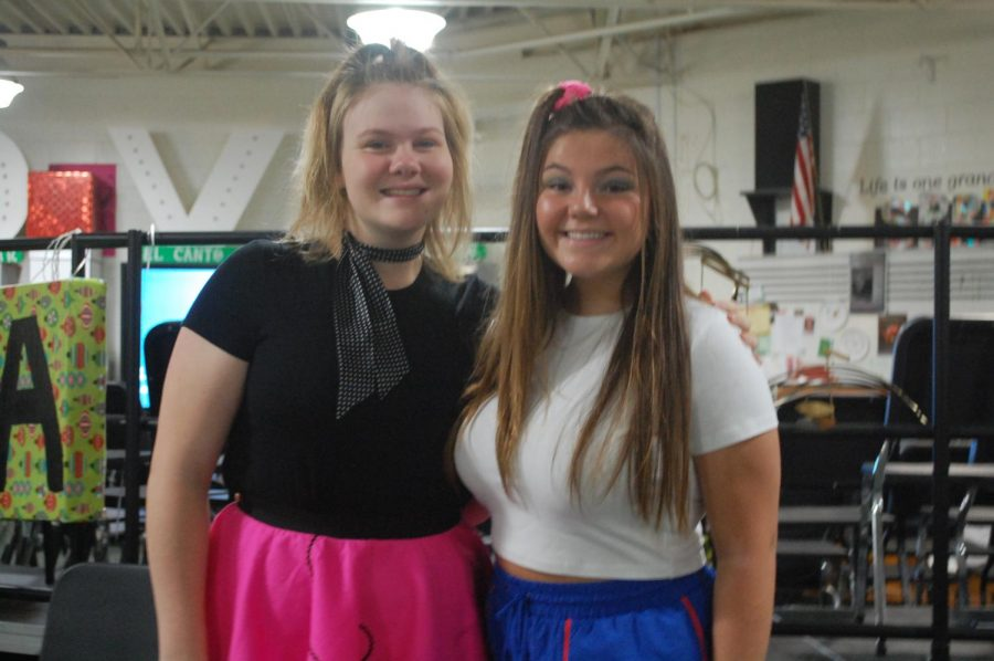Juniors Maya Kulpinski and Tylee Betts dress up for decades day.
