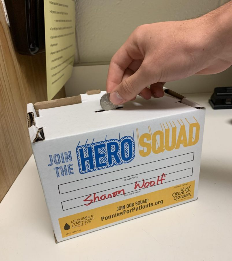 Students+across+McIntosh+donate+money+to+the+fundraiser+through+boxes+labeled+%22Join+the+Hero+Squad.%22