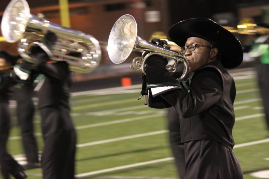 MHS Marching Band member sophomore Adeola Batiste practices for the performance that was rained out.