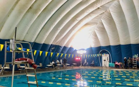 Swim team competes against school rival