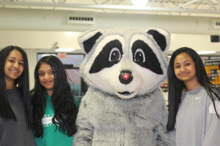 McIntosh Key Club volunteers pose for a picture alongside Flap Jack the Racoon during the 29th Peachtree City Kiwanis Pancake Breakfast.