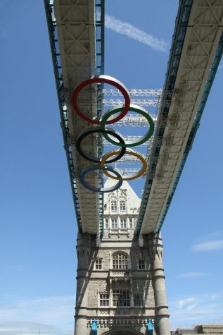 This image shows the Olympic rings hanging under the Tower Bridge during the 2012 London Olympic games.