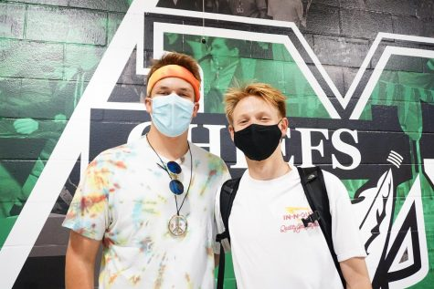 (Left to right) Grant Fouts (12) dressed as the 1960s and Gabe Peacock (12) dressed as the 1980s.