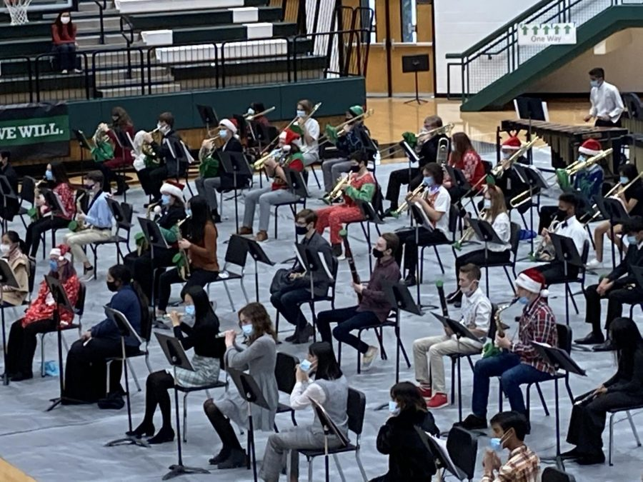 Band students are distanced while playing at their Christmas concert. They play with bell covers to help stay within the regulations of covid.