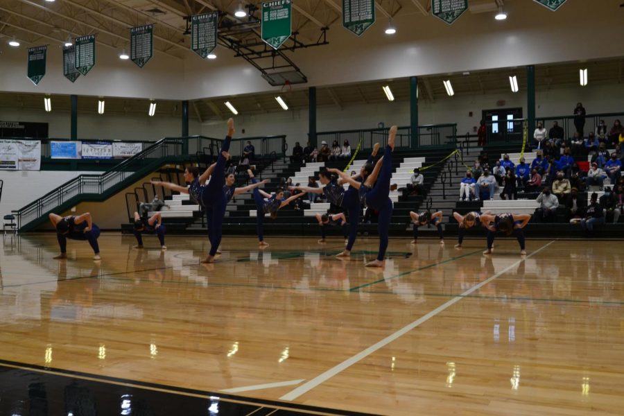 McIntosh Chiefettes dance team gracefully transition into their next move during the McIntosh Dance Invitational.