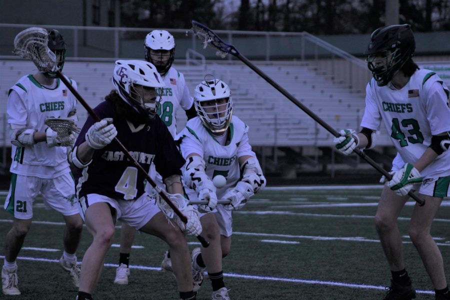 The McIntosh Lacrosse team battles for control of the game in the middle of the field.