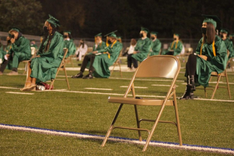 An empty chair at Class of 2020 graduation held in December.