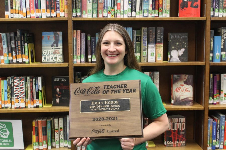 McIntoshs Media Specialist Emily Hodge holding her Teacher of the Year plaque.