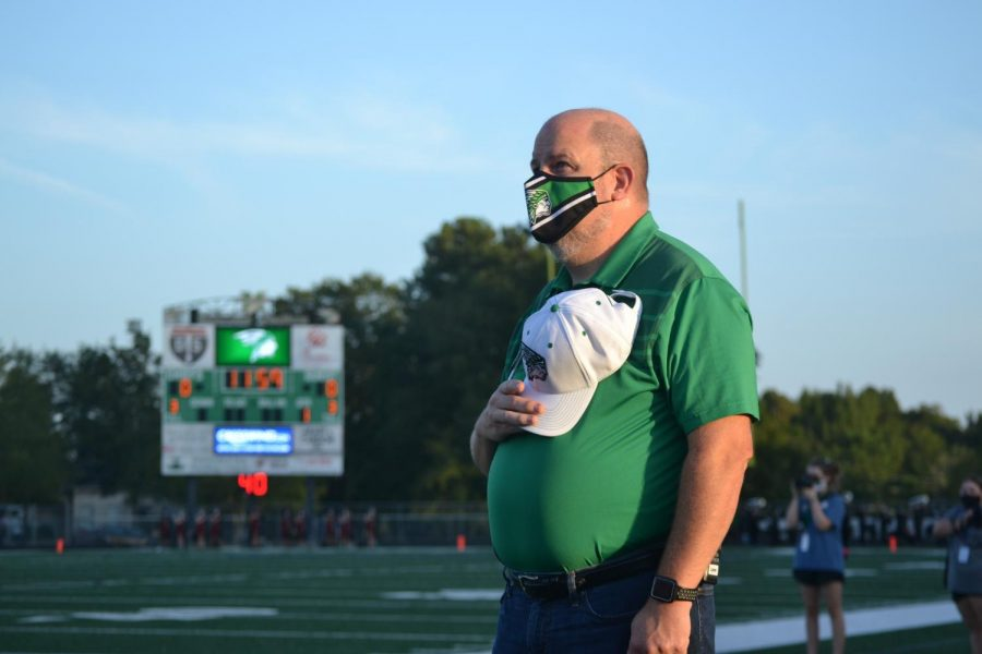 Lane stands for the pledge during one of McIntosh's football games in 2020.
