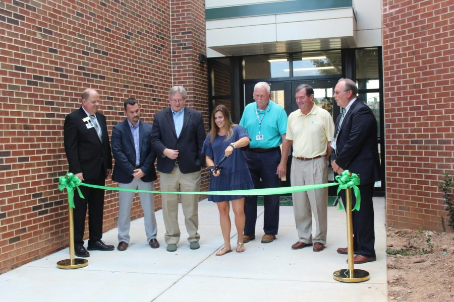 Lane stood in front of the new building during the ribbon cutting ceremony in October of 2019.