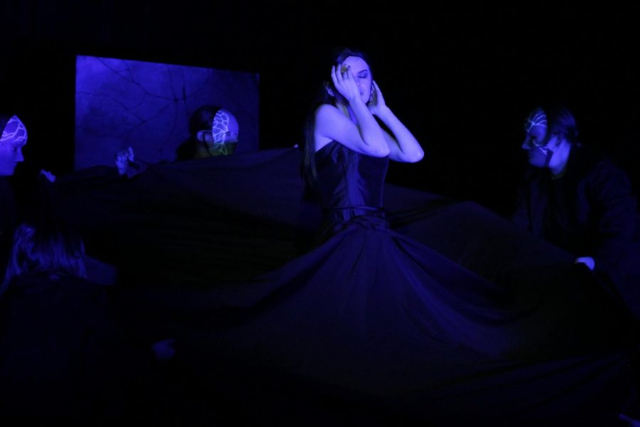 """The Closet of a Raven. In the Competition One Act """"Very Still and Hard to See, Meg Sheets as Obake bathes in the ultraviolet light of her dark underworld. Feature/Entertainment Photograph. All-Georgia."""